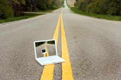 Laptop Computer in the Road royalty free stock photo