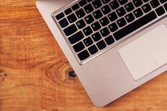 Laptop computer on rustic wooden office desk Stock Images