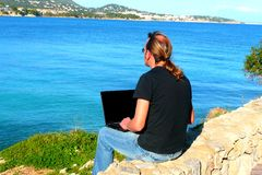 Laptop computer with sea view Stock Photography