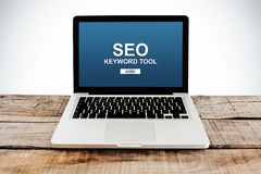 Laptop computer with SEO positioning service in the screen. SEO keywording tool in a laptop screen stock image
