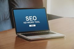 Laptop computer with SEO positioning service in the screen. SEO keywording tool in a laptop screen stock photography
