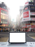 Laptop computer with Shinjuku street background Stock Images