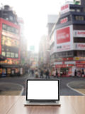 Laptop computer with Shinjuku street background Royalty Free Stock Image