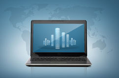 Laptop computer with skyscrapers screen Stock Image