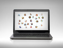 Laptop computer with social network on screen Royalty Free Stock Photo