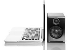Laptop computer and speaker Stock Images