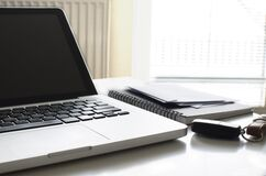Laptop computer and spiral notebook Royalty Free Stock Images