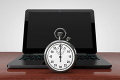 Laptop computer with stopwatch Stock Image