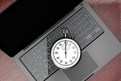 Laptop computer with stopwatch Stock Photos