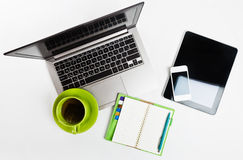 Laptop computer, tablet pc, planner, pen, mobil. Office desk with laptop computer, tablet pc, planner, pen, mobile smartphone and cup of tea on white background Stock Images