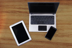 Laptop computer with tablet and smartphone Stock Photos