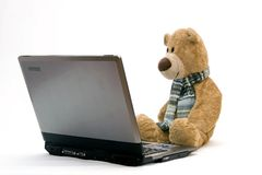 LAPTOP COMPUTER and TEDDY BEAR Royalty Free Stock Photo