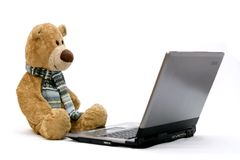 LAPTOP COMPUTER and TEDDY BEAR Royalty Free Stock Images