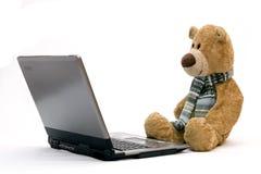LAPTOP COMPUTER and TEDDY BEAR Stock Photos