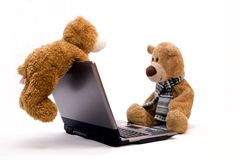 LAPTOP COMPUTER and TEDDY BEAR Stock Photos