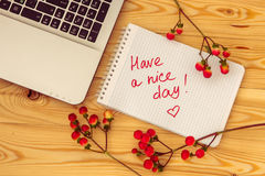 Laptop computer, text Have a nice day and hypericum branches on Stock Image