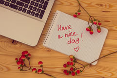 Laptop computer, text Have a nice day and hypericum branches on Stock Images