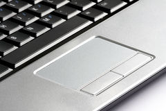 Laptop computer touchpad. An image of laptop computer touchpad, from which, other than using keyboard, users can communicate with the computer to tell what they Stock Photo