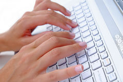 Computer Typing. Business Lady texting typing on a white laptop or computer keyboard Stock Photography