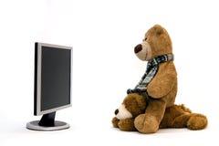 LAPTOP-COMPUTER und TEDDYBÄR Lizenzfreie Stockfotos