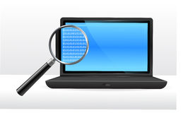 Laptop computer under magnifying glass Stock Photos