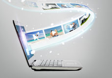Laptop computer with video on screen Stock Photography