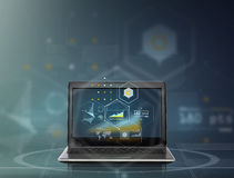 Laptop computer with virtual charts Stock Photography