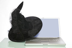 Laptop computer with a witches hat Royalty Free Stock Photos