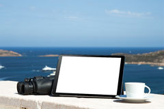 Laptop computer on wood table with sea background Royalty Free Stock Photo