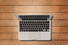Laptop computer on wood table Royalty Free Stock Image