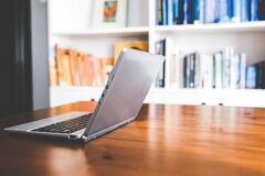 Laptop computer on a wooden desk Royalty Free Stock Images