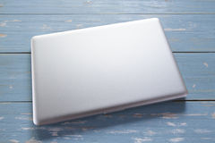 Laptop computer on wooden table. royalty free stock image