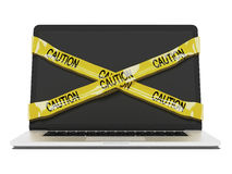 Laptop computer with yellow caution tape. Isolated on a white background. 3d render Royalty Free Stock Images