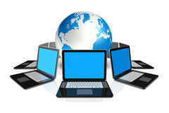 Laptop computers around a world globe Royalty Free Stock Image