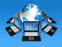 Laptop Computers around World Globe Royalty Free Stock Photo