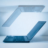 Laptop computers. Concept of two laptop computers reflected which means infinity of technological progression and teamwork Stock Image