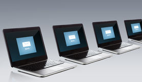 Laptop computers with email message icon on screen Royalty Free Stock Photos