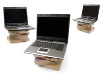 Laptop Computers on Piles of Books. Laptop computers standing on piles of books. Information and education concept stock photos