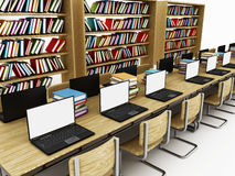 Laptop computers on the table inside a library Stock Images