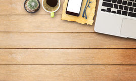 Laptop comuter with cup of coffee on wooden desk Stock Photos