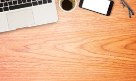 Laptop comuter with smart phone on wooden desk Royalty Free Stock Photos