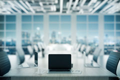 Laptop on conference table Stock Image