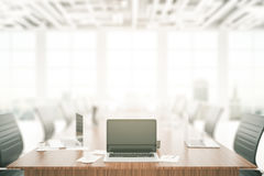 Laptop on conference table Stock Photos