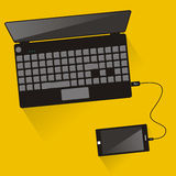 Laptop connected to smartphone. Top view. Communication technolo Stock Image
