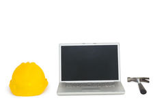 Laptop with construction tools Royalty Free Stock Photos