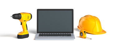 Laptop and construction tools royalty free stock image