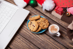 Laptop and cookies wuth cup of coffee Stock Photo