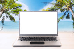 Laptop with copy space on the tropical beach Royalty Free Stock Photography
