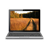 Laptop with country road in a wood on screen Royalty Free Stock Images