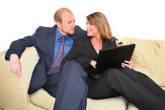 Laptop couple. Man and woman at home working on a laptop royalty free stock photos